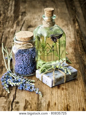 Massage Oil, Herbal Soap And Bath Salt With Fresh Lavender Flowers