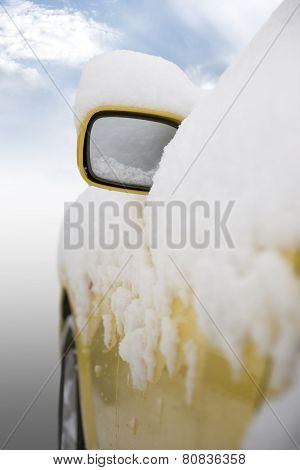 Car With Snow On Mirror