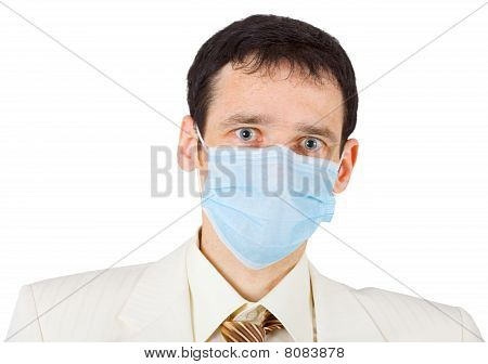Surprised Young Businessman In Mask