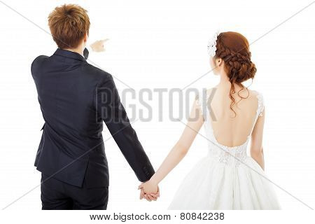 Back View Of Holding Hands Bride And Groom Isolated On White