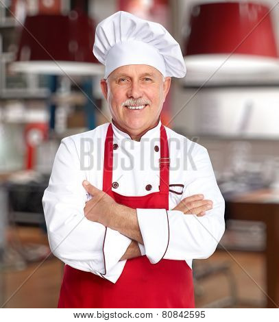Senior professional chef man in modern kitchen