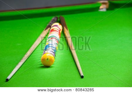 Billiard Ball And Cue On Green Table