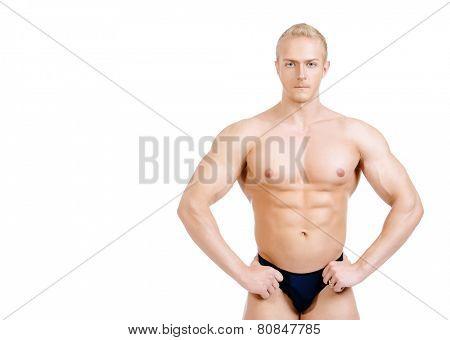 Professional sportsman bodybuilder man. Isolated over white.