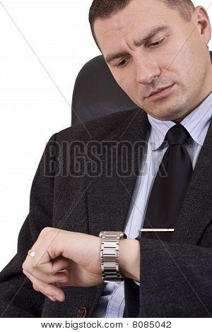Businessman Looking Watch