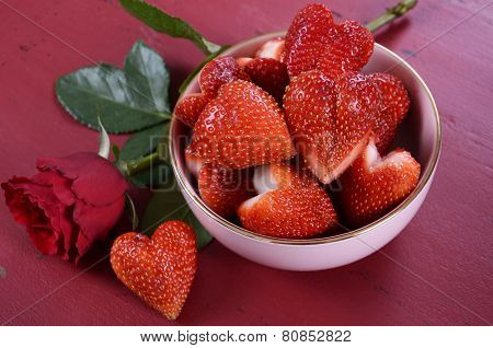 Happy Valentines Day Bowl Of Luscious Heart Shape Red Strawberries On A Red Vintage Wood Background.