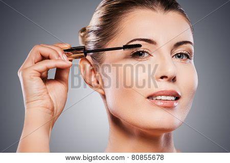 Woman Doing Make-up.