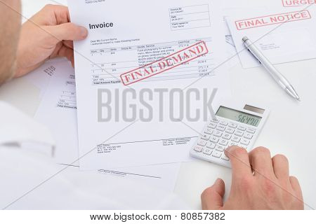 Man Calculating Invoice