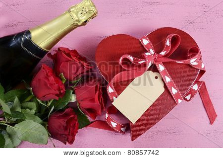 Happy Valentines Day Red Heart Shape Gift Box With Bottle Of Champagne And Red Roses On Shabby Chic