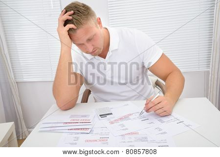 Worried Man Looking At Bills