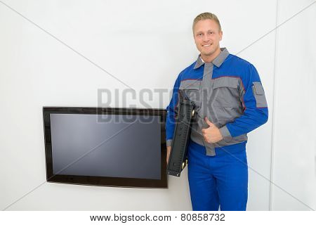Portrait Of Technician Holding Amplifier