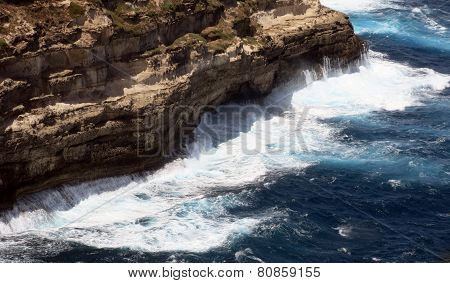 Very High Cliff On The Rough Sea With Waves