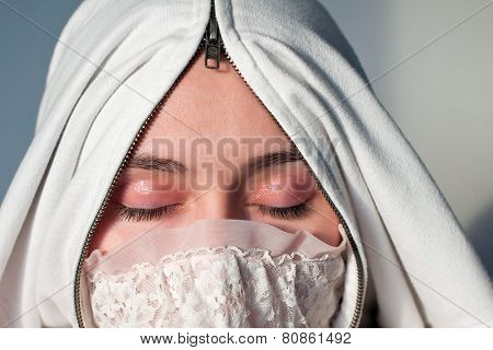Arabian woman wearing hijab. Young girl with closed eyes showing her makeup. Concept of silence, iso