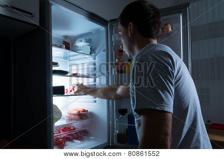 Man Taking Food From Fridge