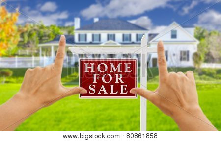 Female Hands Framing Home For Sale Real Estate Sign in Front of New House.