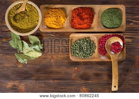 Colorful Herbs,spices And Aromatic Ingredients  On Wooden Table.