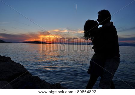 Silhouette Couple Kissing Over Sea Sunset Background