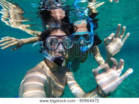 Couple Snorkeling In Maldives