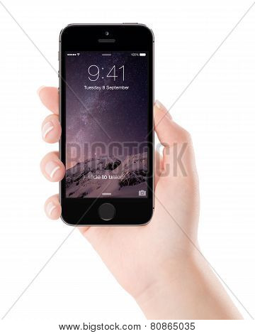 Apple Space Gray Iphone 5S With Lock Screen On The Display In Female Hand, Designed By Apple Inc