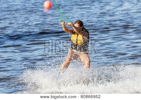 Young Woman study riding wakeboard on a lake