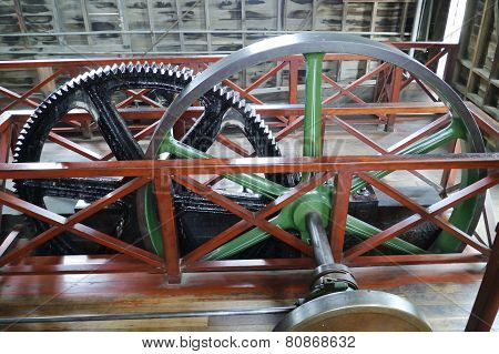 The wheels of a steam engine