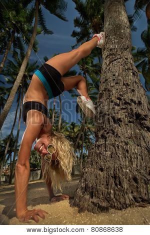 Young woman exercise yoga supported headstand