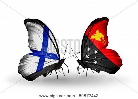 Two Butterflies With Flags On Wings As Symbol Of Relations Finland And Papua New Guinea