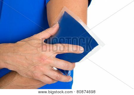 Hand Holding Ice Gel Pack On Elbow