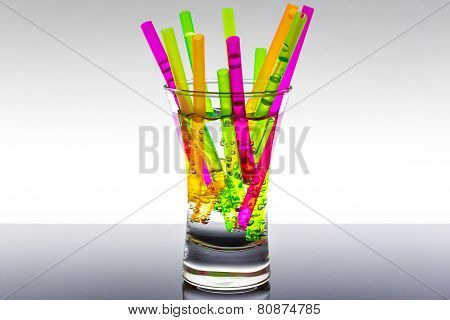 Glass full of straws