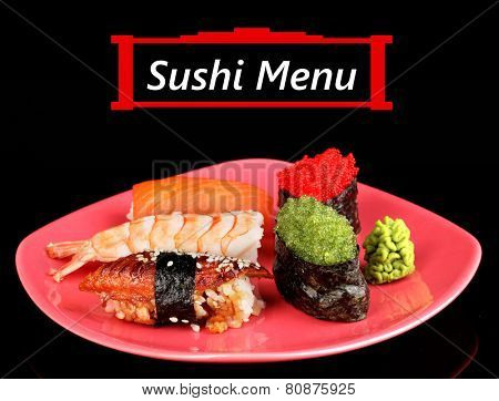 Delicious sushi served on plate isolated on black with space for your text