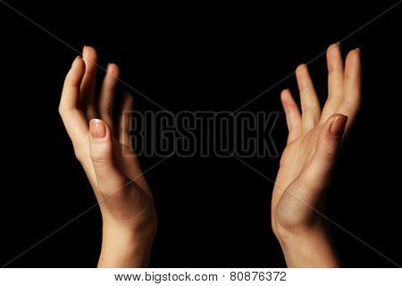 Female hands on dark background