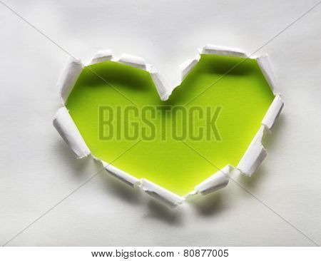 Torn paper heart over colorful background