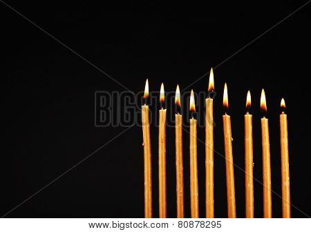Hanukkah menorah with candles isolated on black