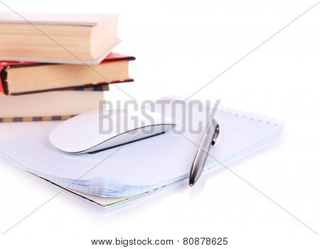 Pile of books and computer mouse isolated on white