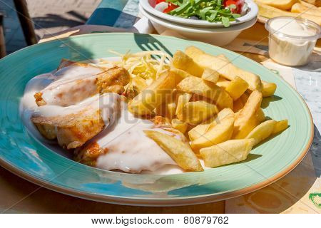 Veal With Cream Sauce, Fries And Salad