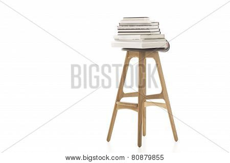 Books On Top Of Wooden Leg Chair