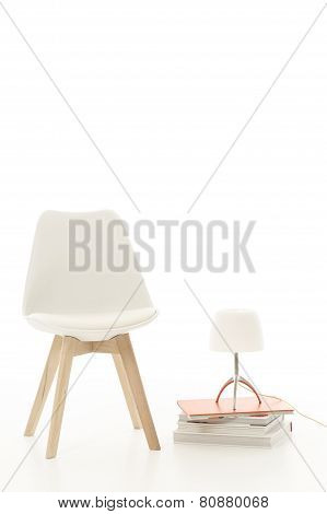 Single Stylish Modern White Chair With A Lamp
