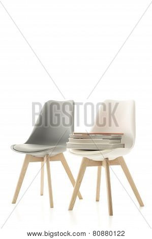 Two Modern Chairs With A Pile Of Books