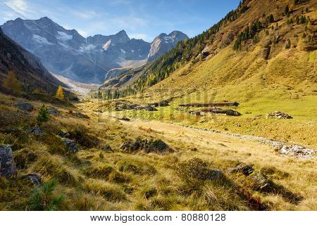 Alpine mountain valley with huts