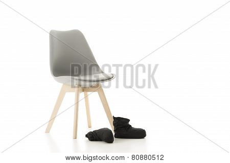 Office Chair And Pair Of Back Shoes On White