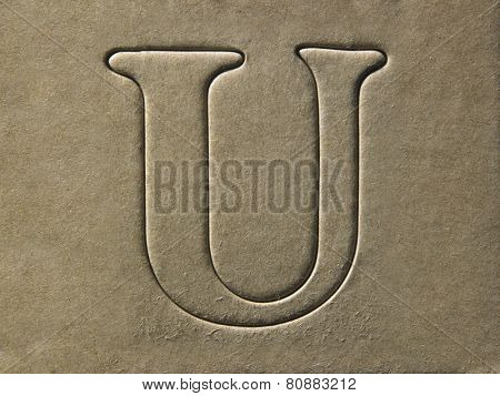 die cut alphabet u on the brown card board