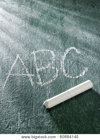 hang writing a b c on the black board