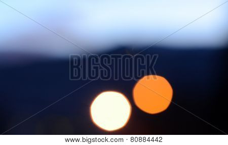 Abstract circular bokeh on dark background.