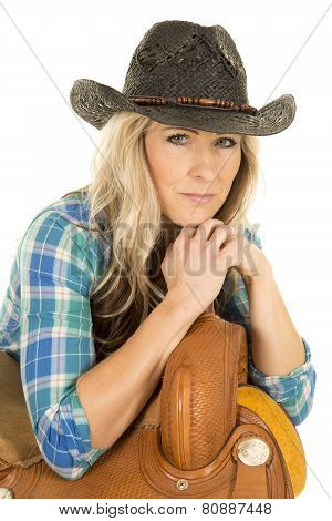 Cowgirl Blue Shirt Black Hat Lean On Saddle Hands On Horn Looking