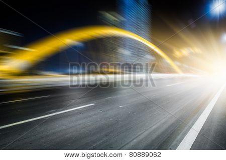 speeding lights of cars in city at night.