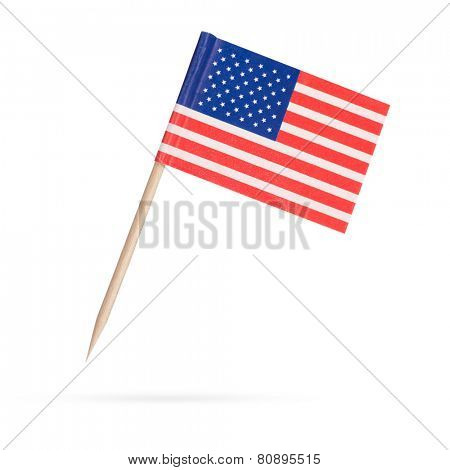 Miniature paper flag USA. Isolated American Flag on white background. With shadow below