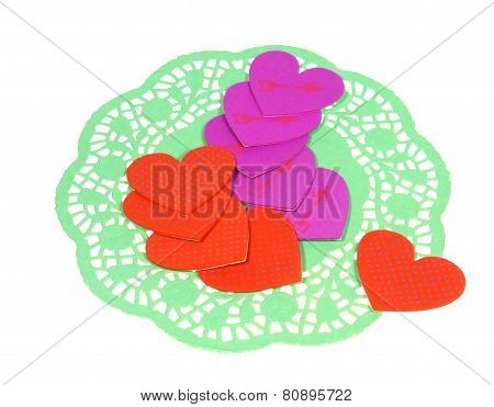 Hearts on a green paper lace doily