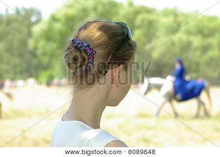 girl watching a horse