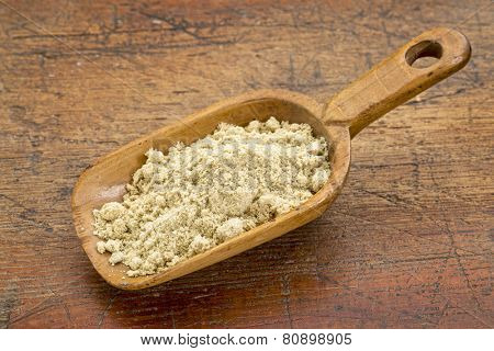 a rustic scoop of rice bran against grunge wood