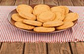 foto of biscuits  - Ginger Biscuits In A Bowl On A Wooden Background - JPG