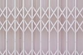 stock photo of metal grate  - Abstract pink metal grille sliding door background - JPG